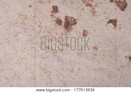 Brown abstract spots on textured fibrous paper or cardboard. Base for your ideas and projects.