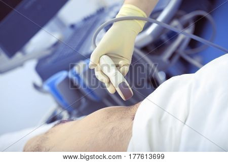 Providing ultrasonic exam to the patient in clinic.