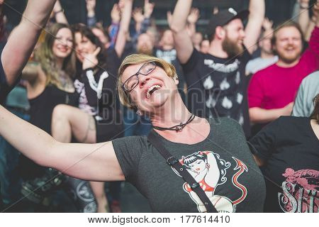 Amsterdam, The Netherlands - March 19, 2017: audience cheering during support act with Norwegian hard rock band Audrey Horne Concert of Canadian hard rock heavy metal band Danko Jones at Melkweg
