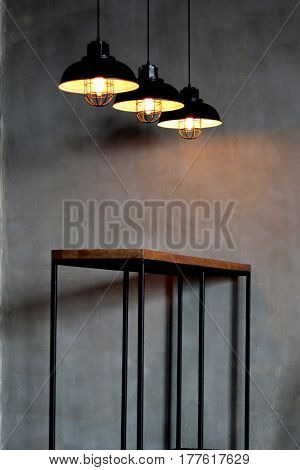 light lamp electricity hanging decorate home interior Hanging over a wooden table. The Ceiling Fixture on wall background.