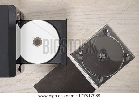 Listen to the music, white cd and black case, audio player.