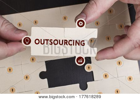 Business, Technology, Internet And Network Concept. Young Businessman Shows The Word: Outsourcing