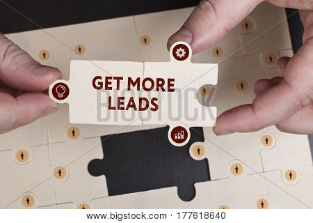 Business, Technology, Internet And Network Concept. Young Businessman Shows The Word: Get More Leads