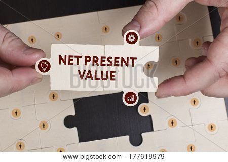 Business, Technology, Internet And Network Concept. Young Businessman Shows The Word: Net Present Va