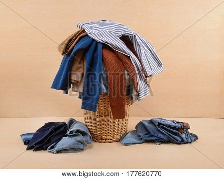 full of jeans, clothes in Basket-wooden background