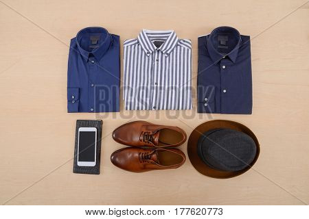 Men's casual outfits with man clothing and accessories on rustic wooden background,
