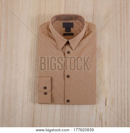 man shirt on wooden background