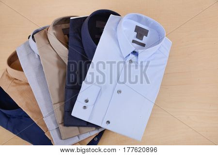 Set of man shirt on wooden background