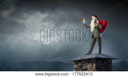 Businessman in Santa hat . Mixed media