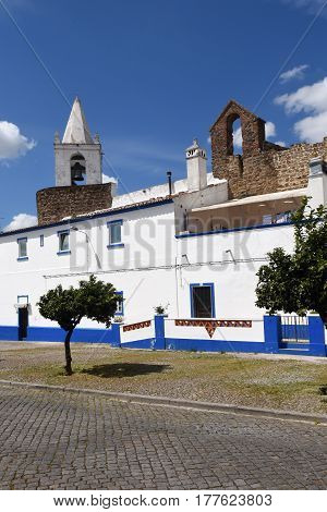 Houses In Front Of The Castle Walls And Church Sinera The Village Of Redondo, Alentejo Region, Portu