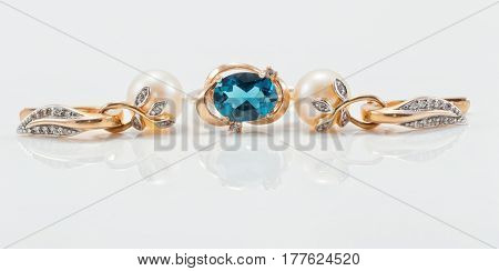 Elegant Gold Ring With Topaz And Gold Earrings With Natural Pearls