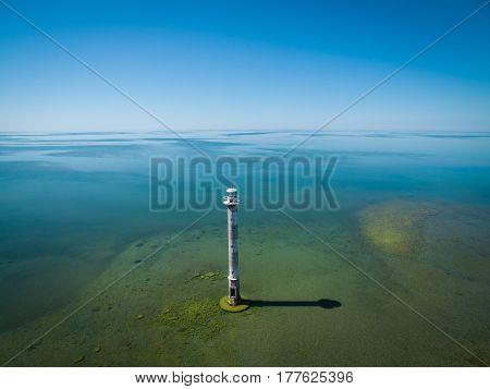 Old lighthouse standing in the sea aerial panoramic view. Estonia Saaremaa island - Kiipsaare tuletorn.
