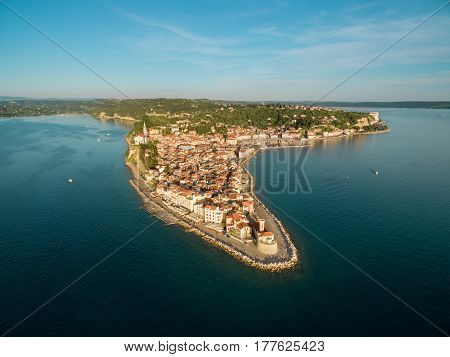 Old city Piran in Slovenia bird's eye view at sunset. Aerial photo.