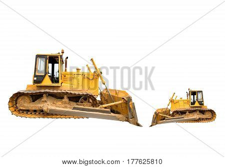 Two heavy dirty building bulldozers of yellow color: big and small isolated on white.