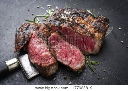 Barbecue aged Wagyu Rib Eye Steak as close-up on slate