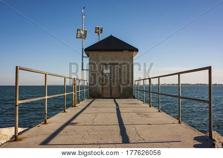 A maintenance cabin in a dam to the sea in Italy.