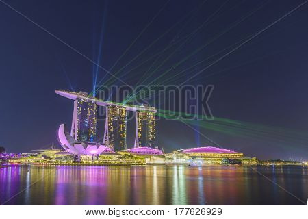 MARINA BAY SINGAPORE - FEBRUARY 10 2017: Landscape of the Marina Bay Sands laser show in Singapore.
