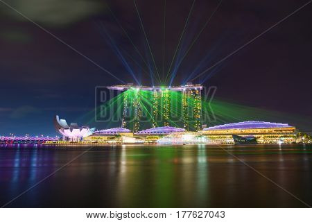 MARINA BAY SINGAPORE - FEBRUARY 15 2017: Landscape of the Marina Bay Sands laser show in Singapore.