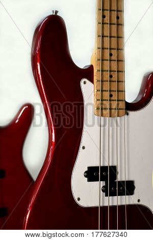 part of red electric bass guitar showing the wire