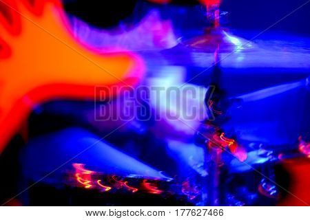 part of the electric guitar and drums part in a concert with a red light