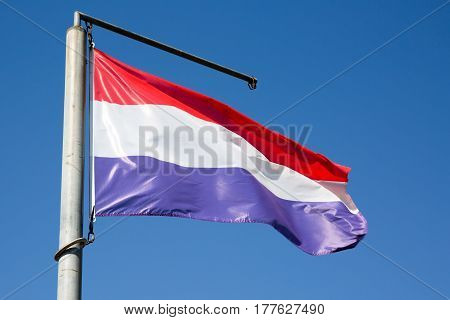 Flag Of The Netherlands Floats In The Sky And The Wind