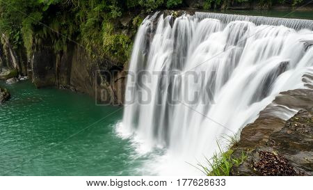 Long Exposure of beautiful Waterfall at Shifen Waterfall in Pingxi District New Taipei City Taiwan