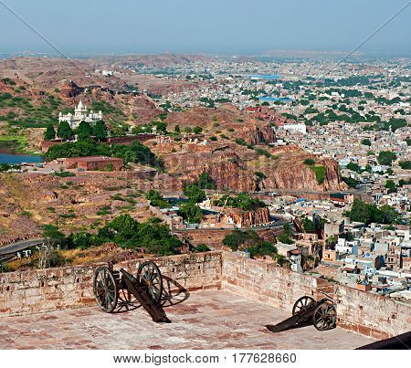 View of the city Jaswant Thada and historical cannons on Mehrangarh Fort in Jodhpur Rajasthan India