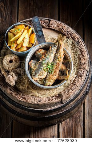 Homemade Herring Fish And Chips With Salt And Herbs
