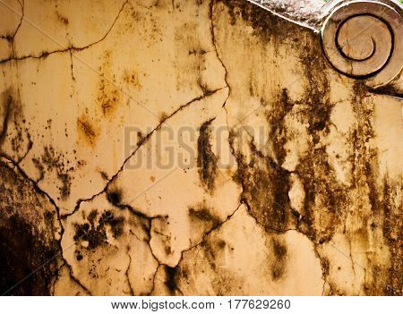 Worn rust and weathered paint on textured cement.