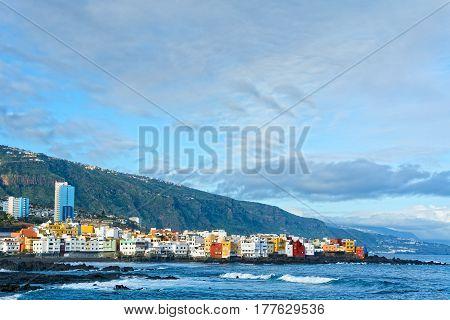 View of colourful houses of Punta Brava from beach Jardin in Puerto de la Cruz Tenerife Canary Islands Spain