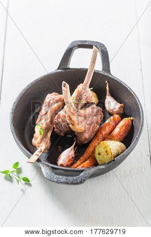 Tasty Grilled Ribs Of Lamb On An Old White Table