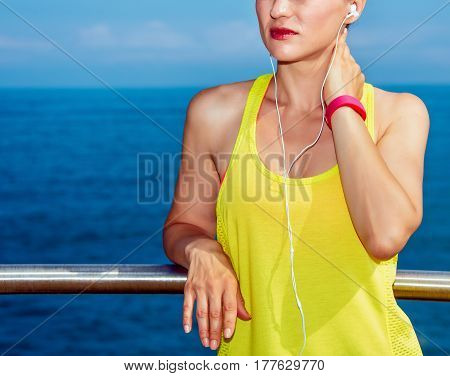 Young Fitness Woman Looking Into Distance At Embankment