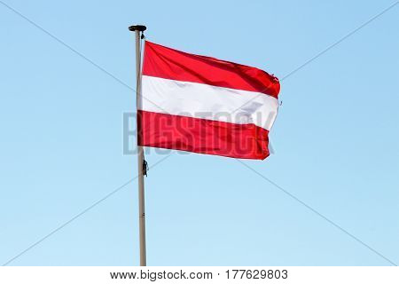 Flag Of French Polynesia In The Wind And Sky