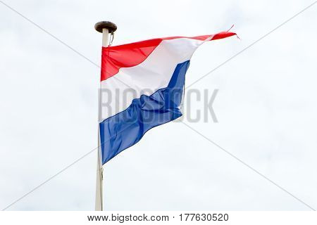 Flag Of The Netherlands Floats In The Sky