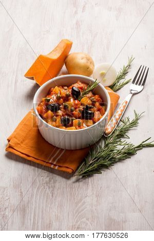 ratatouille with pumpkin capers potatoes and black olives