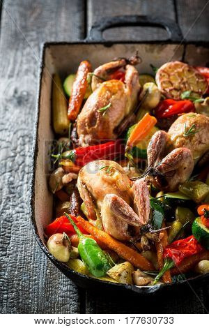 Homemade Quails With Spices And Vegetables In Casserole