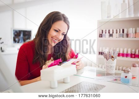 Woman at beauty salon enjoying manicurist treatment