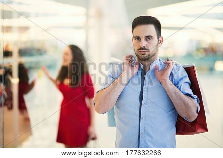 Unhappy husband worried about finances while shopaholic wife spends money