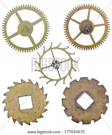 five old brass gears isolated on white background