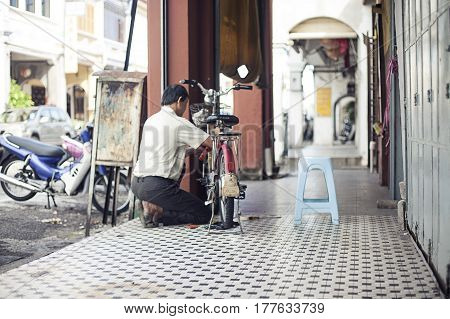 Penang, Malaysia. Vintage Trishaw stop beside road for service traveller