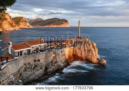 Seaside landscape with wild rocky shoreline in Petrovac, Montenegro.