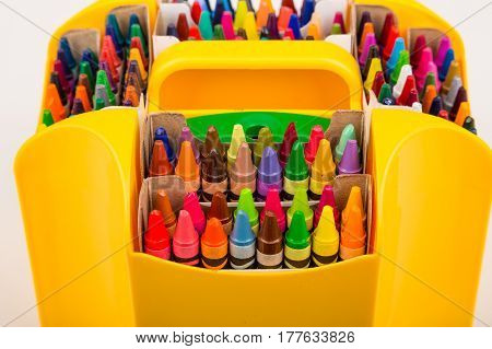 Many Colorful Crayons in a Yellow Caddy