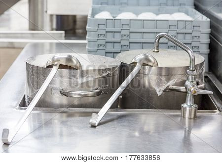 Ladles on Stock Pots in Commercial Kitchen