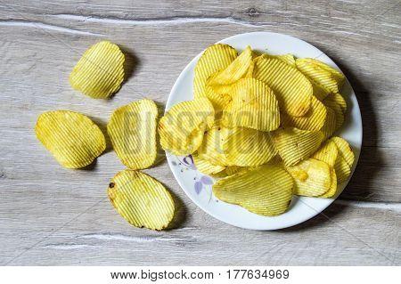 Potato and potato products, fried potato slices, fried serrated potato slices, fried potato chips