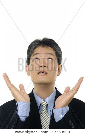 Stock photo of a surprised businessman looking up