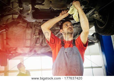 Car mechanics working on modern car maintenance