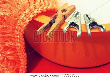 Clothespin,sponge,basin.Large Laundry.Photo toned in retro style.Household items in retro style close-up.