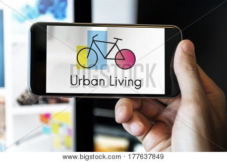 Hands Holding Smart Phone with Bike Icon