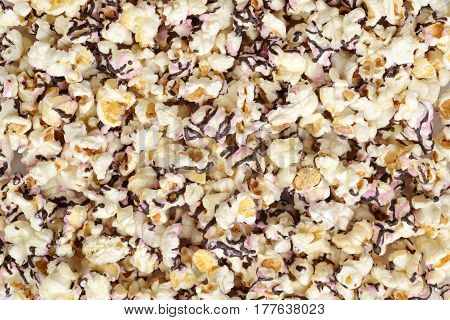 dark chocolate and raspberry popcorn making a background