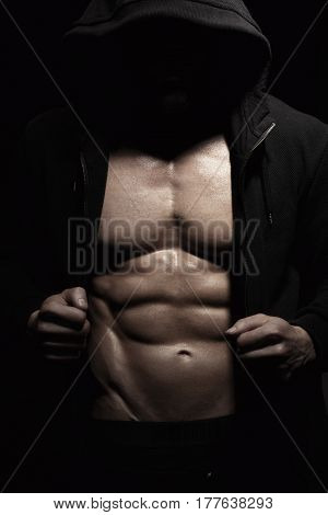 Athletic Strong Sexual Man Abs Six Pack Muscles Bodybuiding And Fitness Concept. Studio shot, Low key